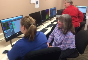 Adult Ed students learning to code computer programs